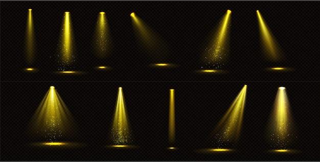 Gelbe scheinwerferstrahlen mit goldschimmern Kostenlosen Vektoren