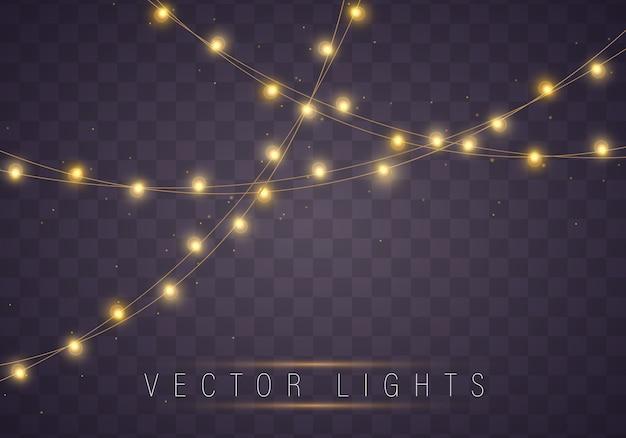 Gelbe weihnachtslichter lokalisierten realistische elemente. Premium Vektoren