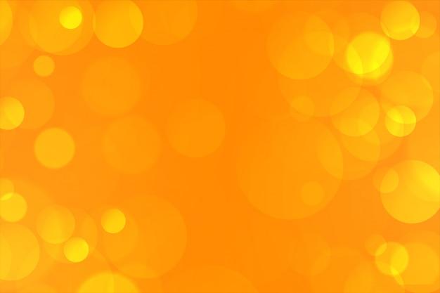 Gelbes elegantes bokeh beleuchtet hintergrund reizend Kostenlosen Vektoren