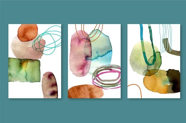 Gemalte aquarellformen decken packung ab Kostenlosen Vektoren