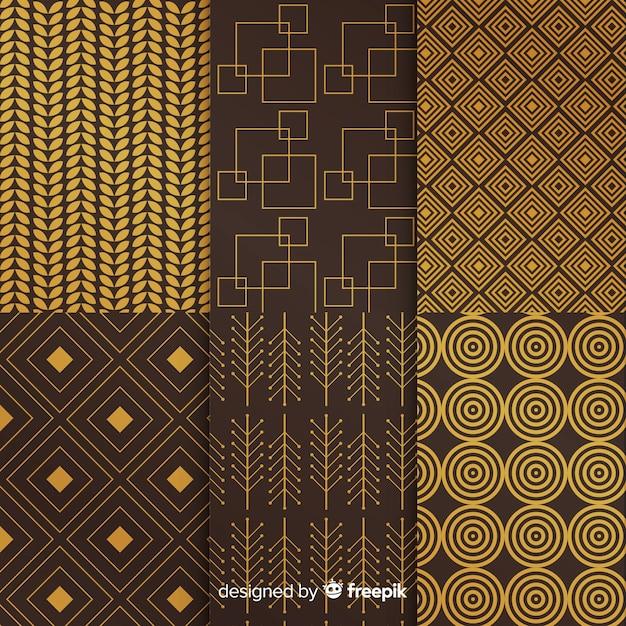 Geometrische luxussammlung der dunkelheit und des goldes Kostenlosen Vektoren