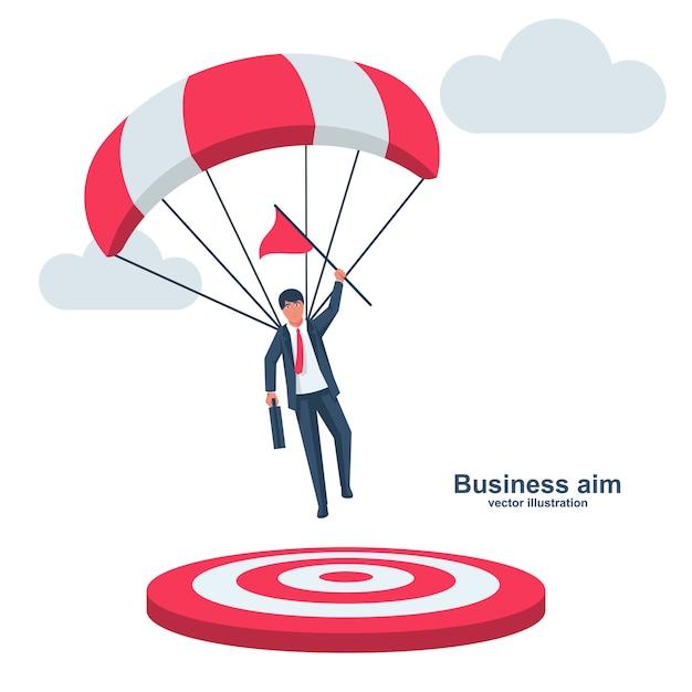 Geschäftsmann auf einem fallschirm mit einer flagge landet auf ziel. symbol champion Premium Vektoren