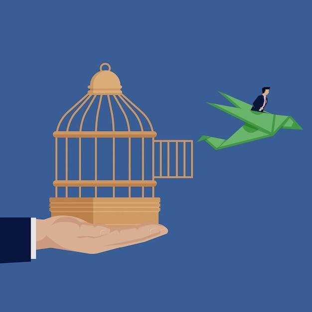 Geschäftsmann aus birdcage mit dollarorigamivogel heraus. Premium Vektoren