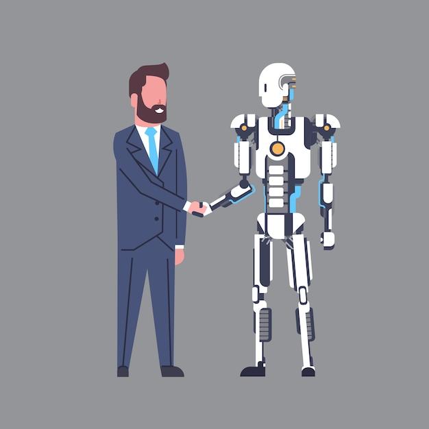 Geschäftsmann, der hände mit modernem roboter-künstlicher intelligenz-mechanismus-technologie-konzept rüttelt Premium Vektoren