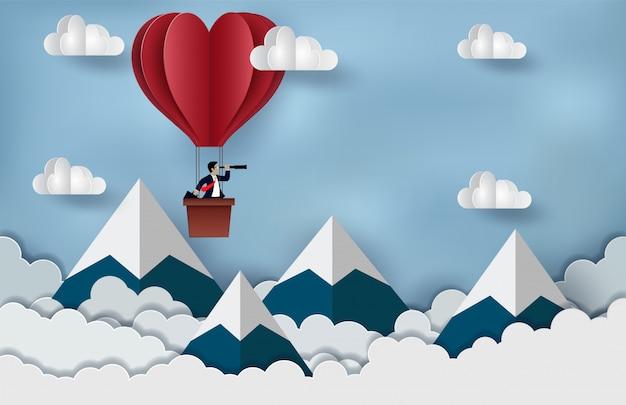 Geschäftsmann, der in der roten haltenen binokularen schwimmen des heißluftballons auf den himmel steht Premium Vektoren