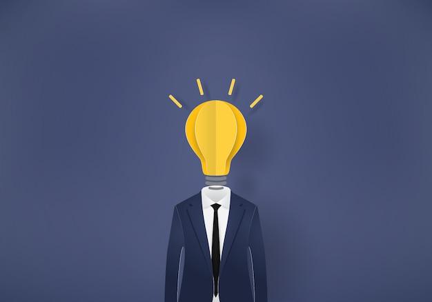 Geschäftsmann glühbirne, papierschnitt Premium Vektoren