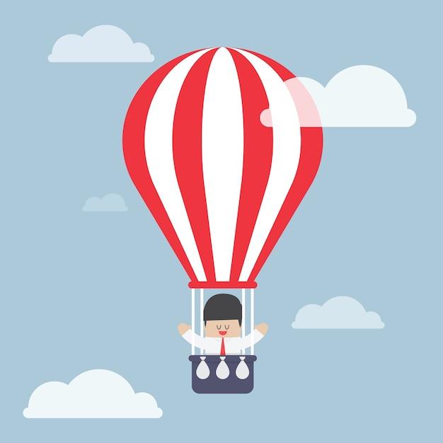 Geschäftsmann im heißluftballon Premium Vektoren