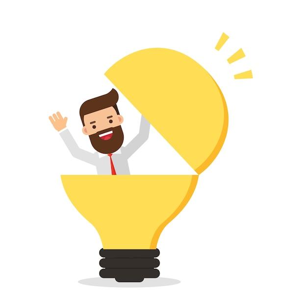 Geschäftsmann in einer glühbirne Premium Vektoren