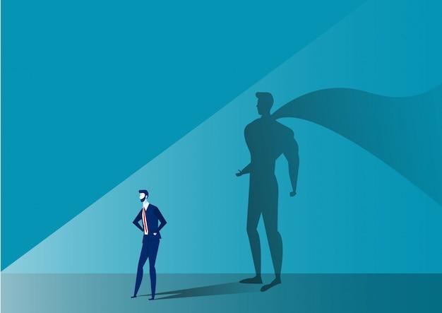 Geschäftsmann mit großem schattensuperheld auf blau Premium Vektoren