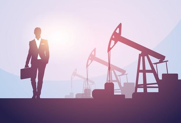 Geschäftsmann pumpjack oil rig crane platform banner Premium Vektoren