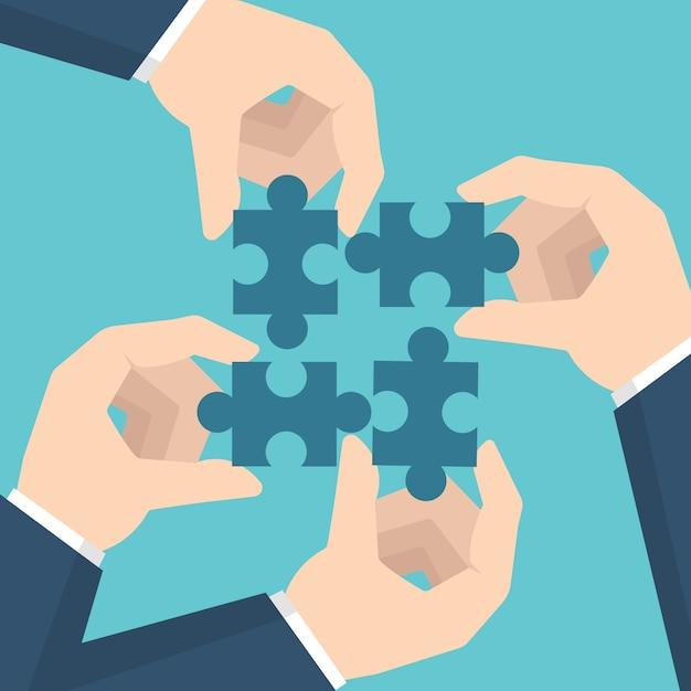 Geschäftsmannhände, die puzzle halten. teamwork-konzept. Premium Vektoren