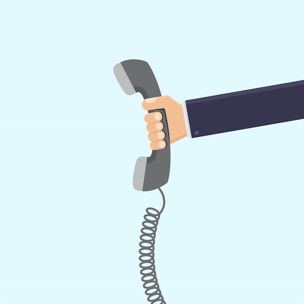 Geschäftsmannhand, die flache illustration des retro- telefons hält Premium Vektoren