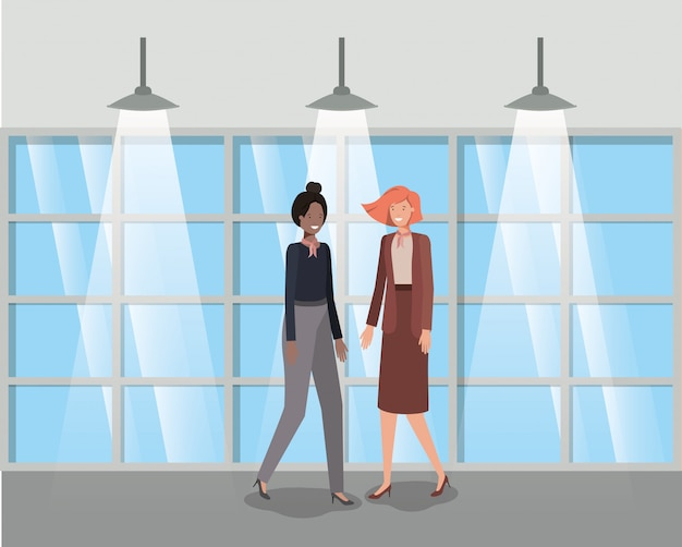 Geschäftsfrauenpaare im Korridorbüro Premium Vektoren