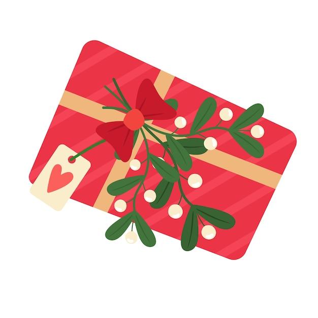 Geschenkbox mit mistelzweig und postkarte. im flachen cartoon-stil. Premium Vektoren