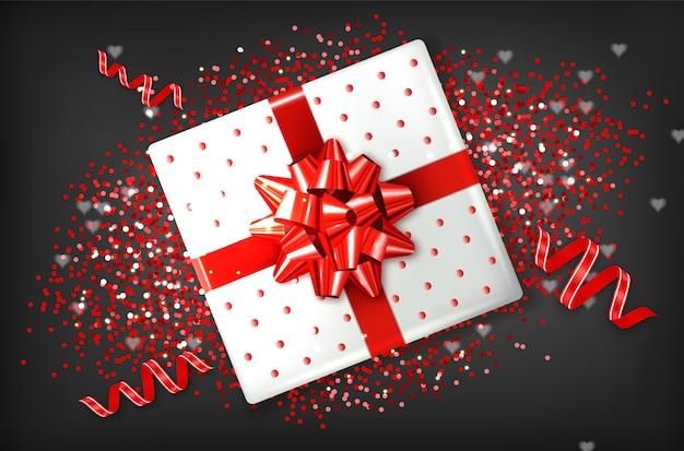 Geschenkbox mit roter schleife Premium Vektoren