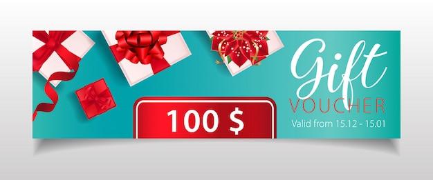 Geschenkgutscheinbeschriftung mit geschenkboxen und weihnachtssternblüte Kostenlosen Vektoren