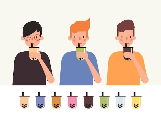 Getränk-blasenmilchtee des jungen mannes. Premium Vektoren