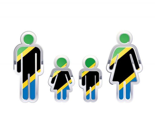 Glänzendes metallabzeichenikone in mann-, frauen- und kinderformen mit tansania-flagge, infografikelement auf weiß Premium Vektoren