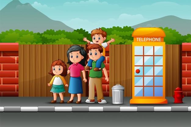 Glückliche familie am straßenrand Premium Vektoren