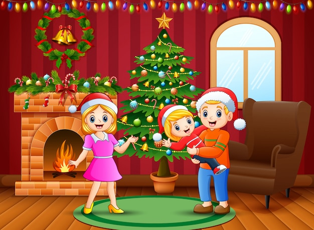 Glückliche familie, die ein weihnachten am haus feiert Premium Vektoren