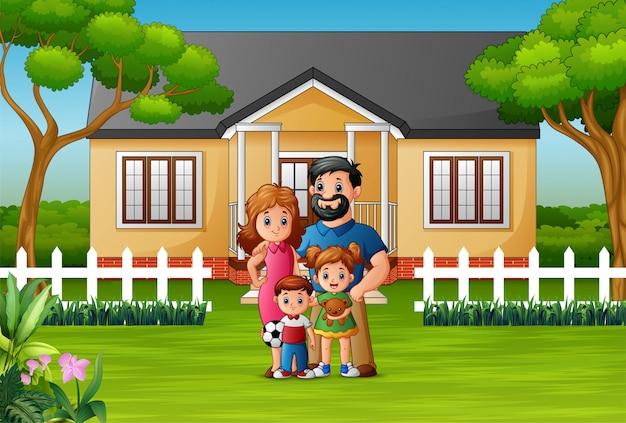 Glückliche familie, die vor dem haus steht Premium Vektoren