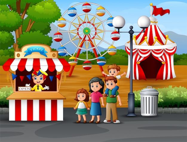 Glückliche familie im vergnügungspark Premium Vektoren