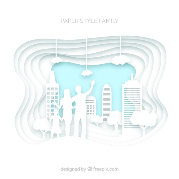 Glückliche familie in der papierkunstart Kostenlosen Vektoren