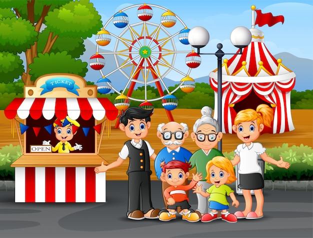 Glückliche familienerholung im vergnügungspark Premium Vektoren