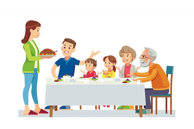 Glückliche große familie, die zusammen abendessen isst Premium Vektoren