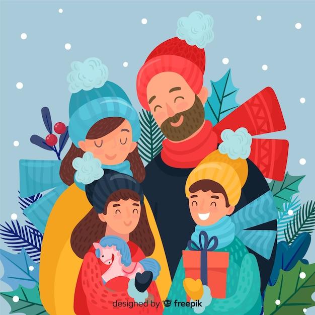 Glückliche hand gezeichnete familie, die weihnachten feiert Kostenlosen Vektoren