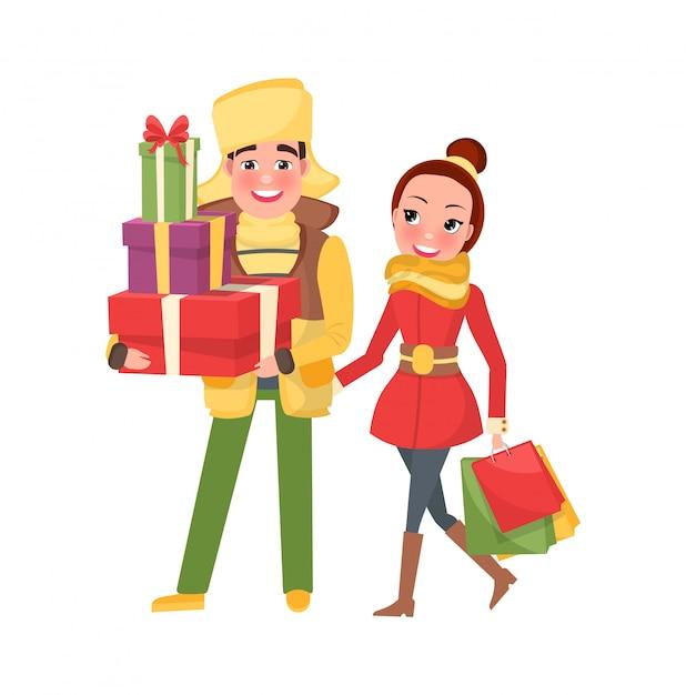 Glückliche junge familie, die zu weihnachten eve fertig wird Premium Vektoren