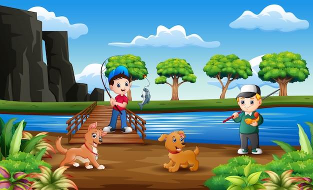 Glückliche jungen, die mit seinem haustier an der holzbrücke fischen Premium Vektoren