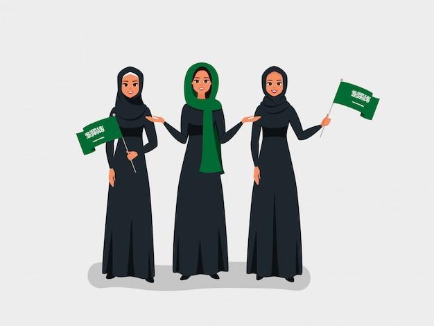 Glückliche saudische frauen feiern den unabhängigkeitstag des königreichs saudi-arabien. Premium Vektoren