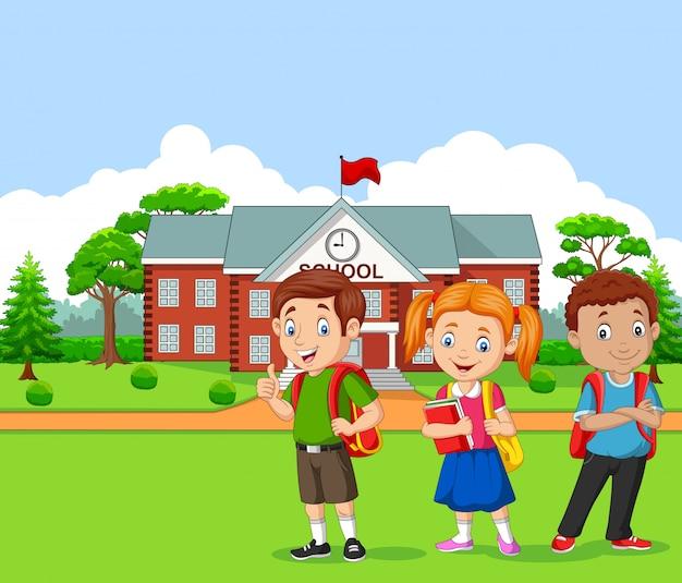 Glückliche schulkinder vor der schule Premium Vektoren