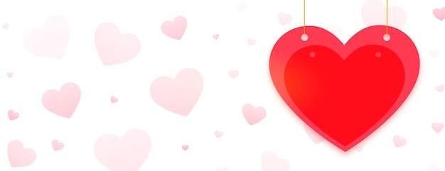 Glücklicher valentinstag-grußfahne mit rotem herzen Kostenlosen Vektoren