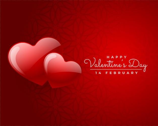 Glücklicher valentinstag zwei rote herzen lieben kartenentwurf Kostenlosen Vektoren