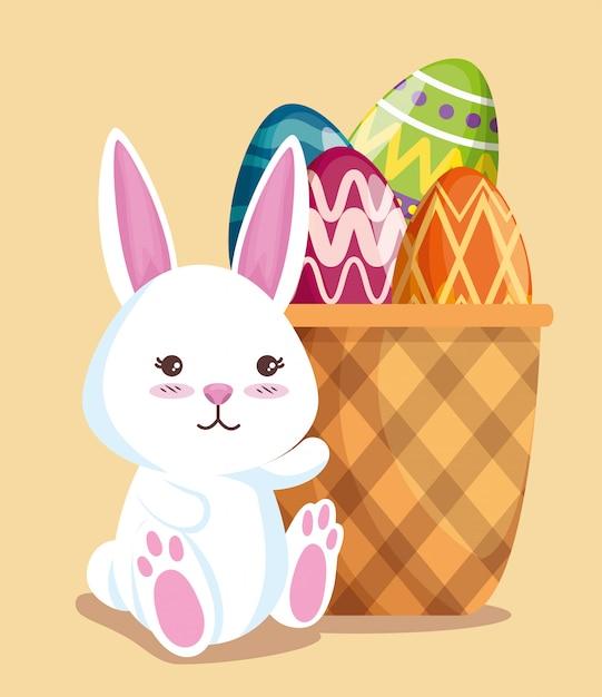 Glückliches kaninchen mit eidekoration im korb Kostenlosen Vektoren