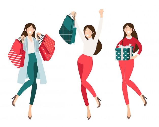 Glückliches shopaholic mädcheneinkaufen für weihnachtssammlung Premium Vektoren