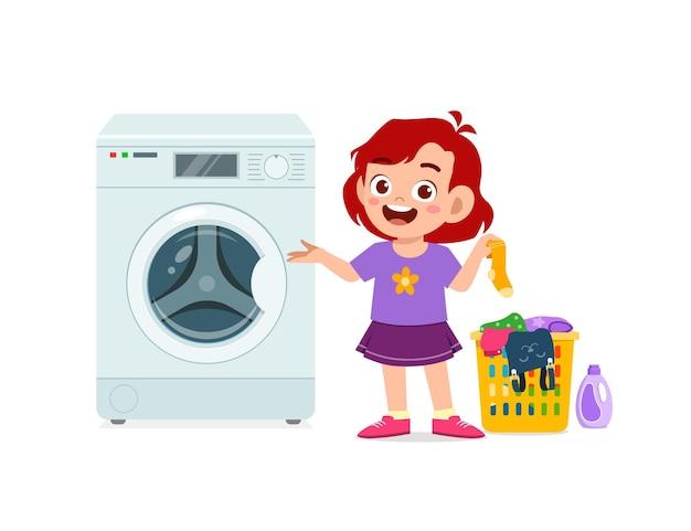 Glückliches süßes kind macht wäsche mit waschmaschine Premium Vektoren