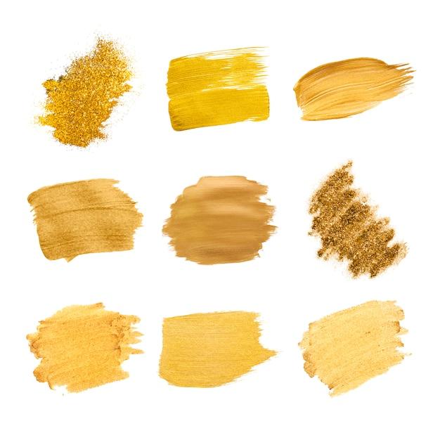 Gold pinselstriche sammlung Kostenlosen Vektoren