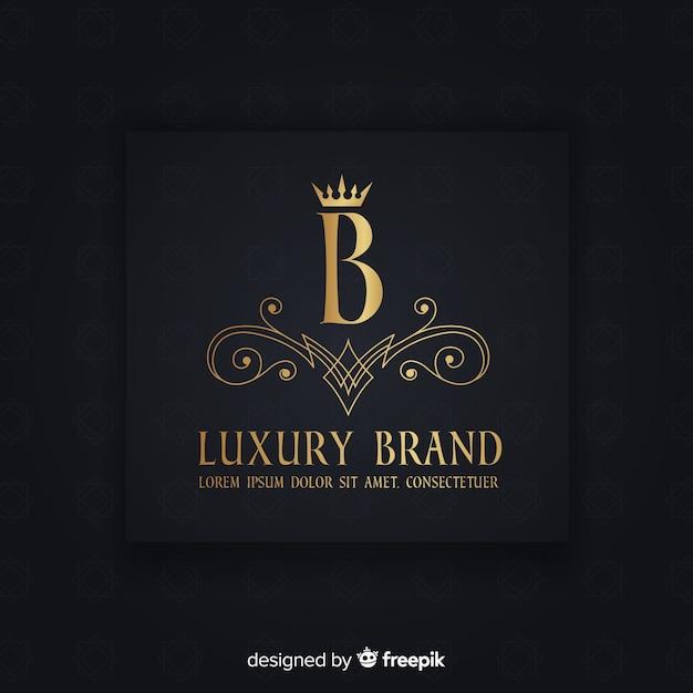 Goldene elegante logoschablone mit verzierungen Kostenlosen Vektoren