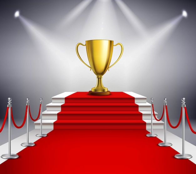 Goldene trophäe auf der weißen treppe bedeckt mit rotem teppich und durch scheinwerfer belichtet Kostenlosen Vektoren