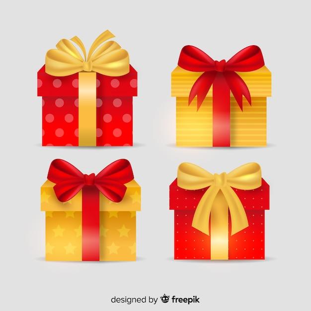 Goldene und rote geschenkboxen mit band Kostenlosen Vektoren