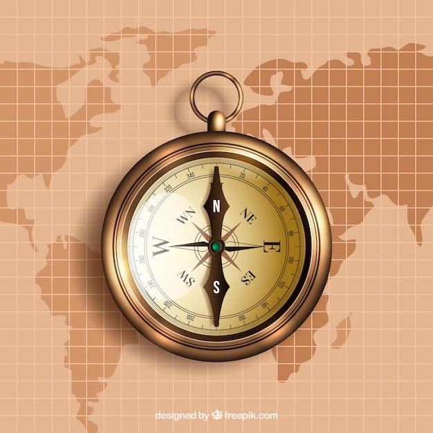 Goldener kompass auf weltkarte hintergrund Kostenlosen Vektoren