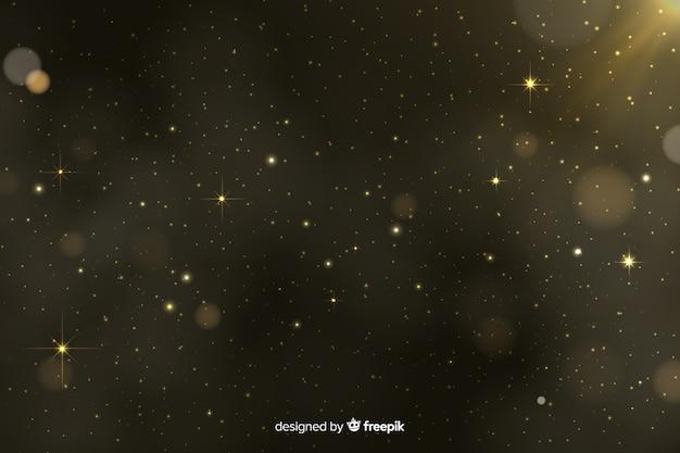 Goldener partikel bokeh hintergrund Premium Vektoren