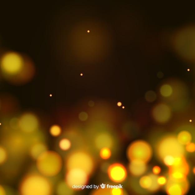 Goldener partikelhintergrund in der bokeh art Kostenlosen Vektoren