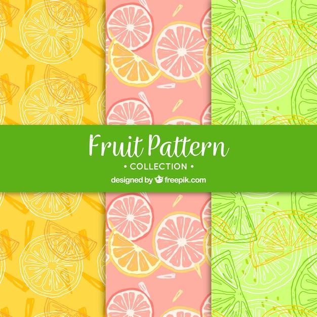 Große muster von fruchtscheiben in handgezeichneten stil Kostenlosen Vektoren