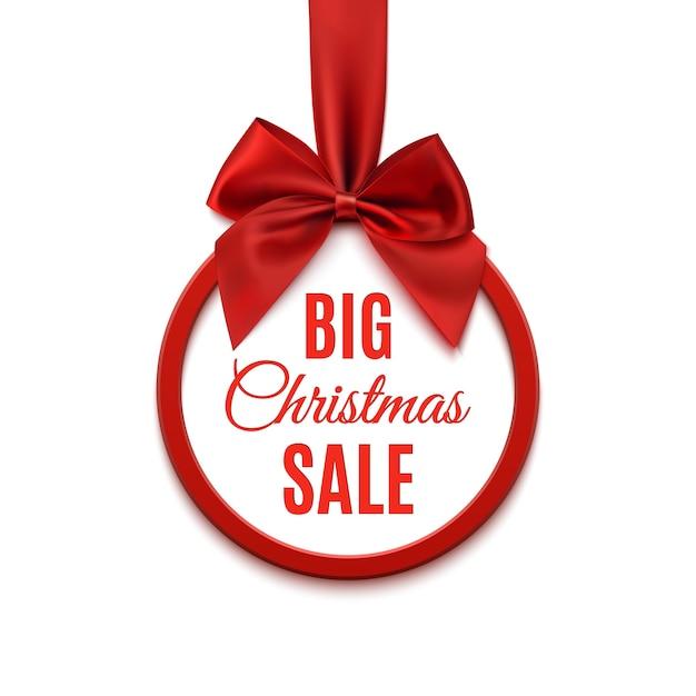 Großer weihnachtsverkauf, rundes banner mit rotem band und schleife, lokalisiert auf weißem hintergrund. Premium Vektoren