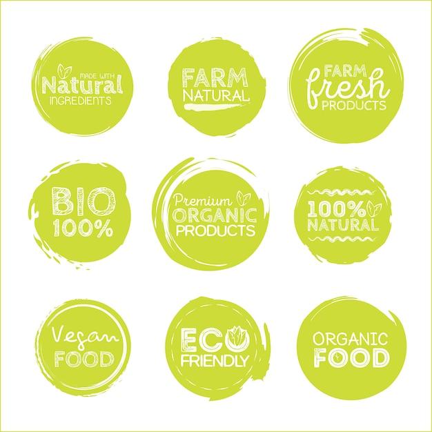 Grüne öko-lebensmitteletiketten. gesundheit überschriften. Premium Vektoren