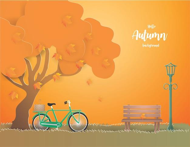 Grünes fahrrad unter dem baum in der herbstillustration. Premium Vektoren